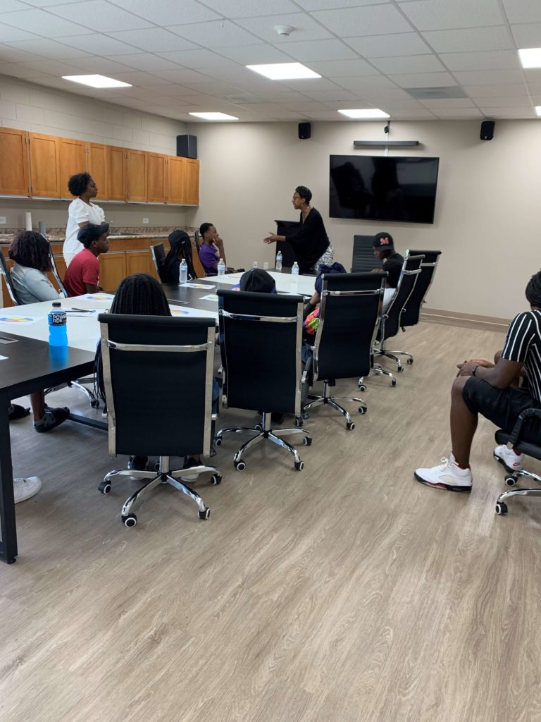 Judge Colvin offers insight and encouragement to children attending the AfterZone Camp at Booker T. Washington Center in the Pleasant Hill neighborhood.